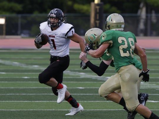 Stevens Point's Colton Kizewski scored three touchdowns last week against Kimberly. Here he runs against Oshkosh North last year.