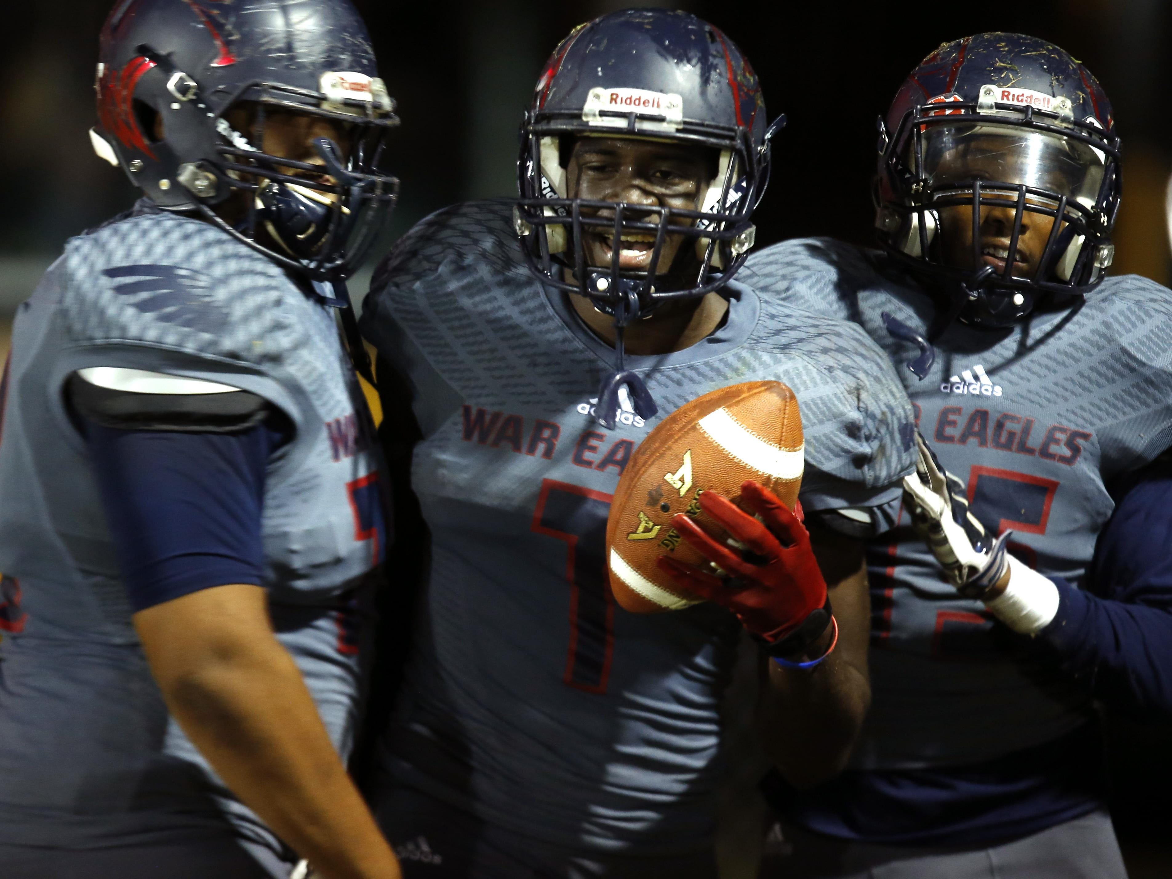 Wakulla's Keith Gavin, center, celebrates with teammates after running a punt back for a touchdown in their playoff win two weeks ago against Rickards.