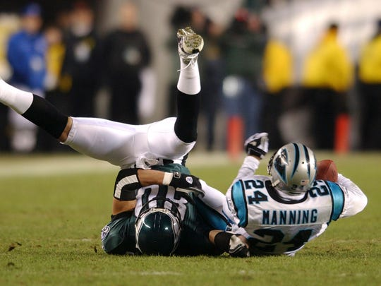 Carolina Panthers Ricky Manning Jr., right, hauls in an interception intended for Philadelphia Eagles James Thrash, left, in the second quarter during the NFC championship game Sunday, Jan. 18, 2004, in Philadelphia.
