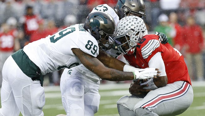 Michigan State and Ohio State are at the top of the Big Ten football ladder. Neither is leading the way in terms of high-end academic achievement among football players.