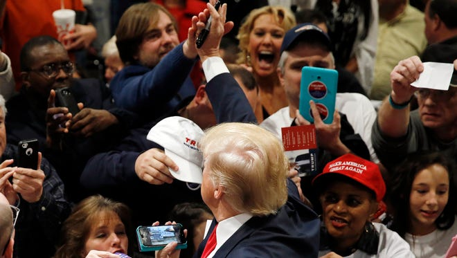 Republican presidential candidate Donald Trump meets with attendees during a campaign stop Friday, Feb. 19, 2016, in North Charleston, S.C. (AP Photo/Matt Rourke)