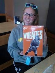 Lauren Hill with her Wheaties box.