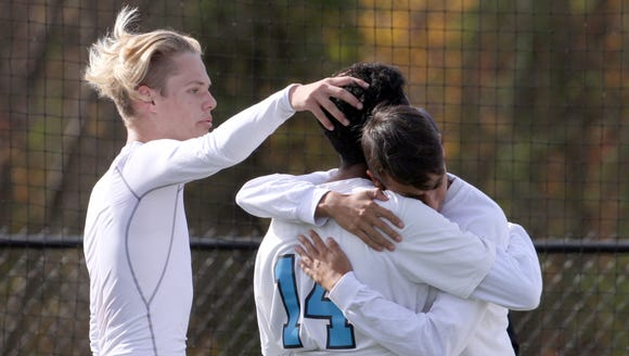 Rye Neck players console each other after Center Moriches