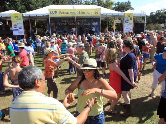 FILE PHOTO Festival-goers dance at Scene Mon Heritage