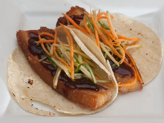 A Pork Belly Tacos are among the lighter fare at The Local Eatery and Pub in Mount Holly.