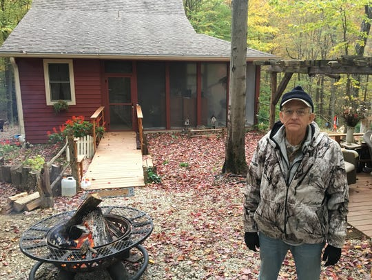 Dave Shoopman in front of his Brown County home in