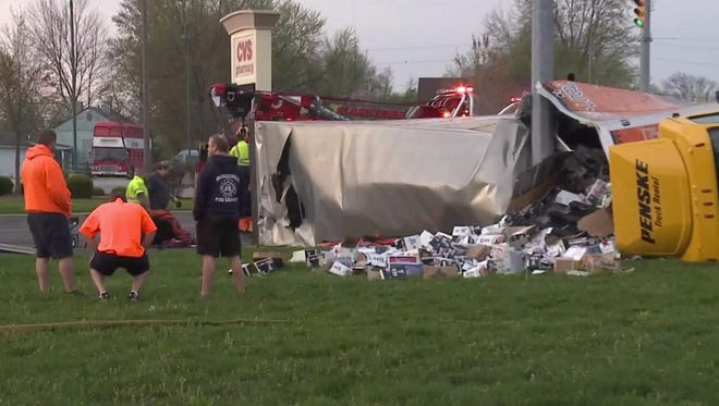 Cases of beer spill from a crashed semi-tractor trailer Tuesday in Hancock County.