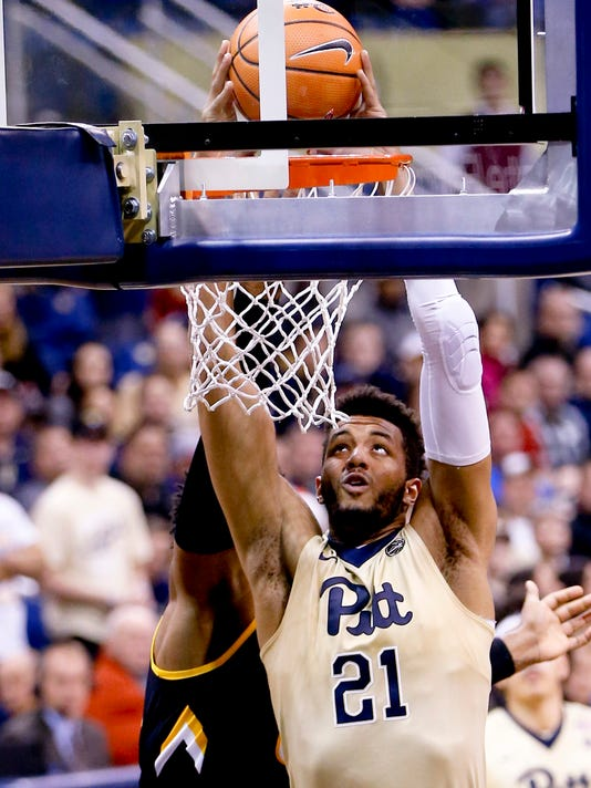 Pittsburgh's Terrell Brown (21) dunks in front of Towson's Alex Thomas during the first half of an NCAA college basketball game, Friday, Dec. 22, 2017, in Pittsburgh. (AP Photo/Keith Srakocic)