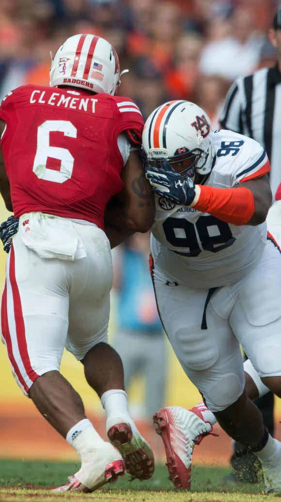 Auburn defensive lineman Angelo Blackson hits Wisconsin