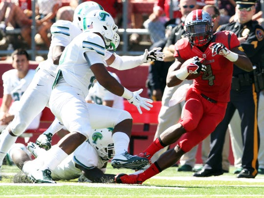 In this file photo Rutgers #4 Leonte Carroo gets away from a host of Tulane defenders.