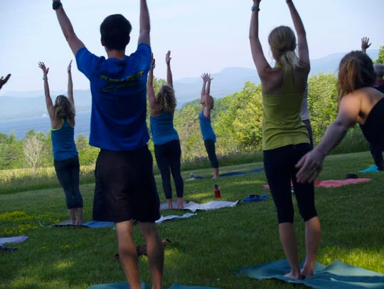A group of 19 took an outdoor yoga class at All Souls