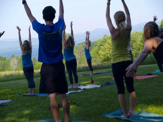 A group of 19 took an outdoor yoga class at All Souls Interfaith Gathering in Shelburne on Sunday, June 26, 2016.