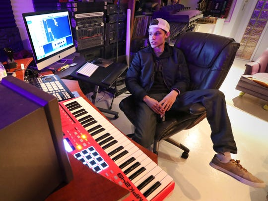 Eriq Zazueta is creating music under the stage name of EriQ Z in a recording and production studio in the basement of his family's Franklin home.