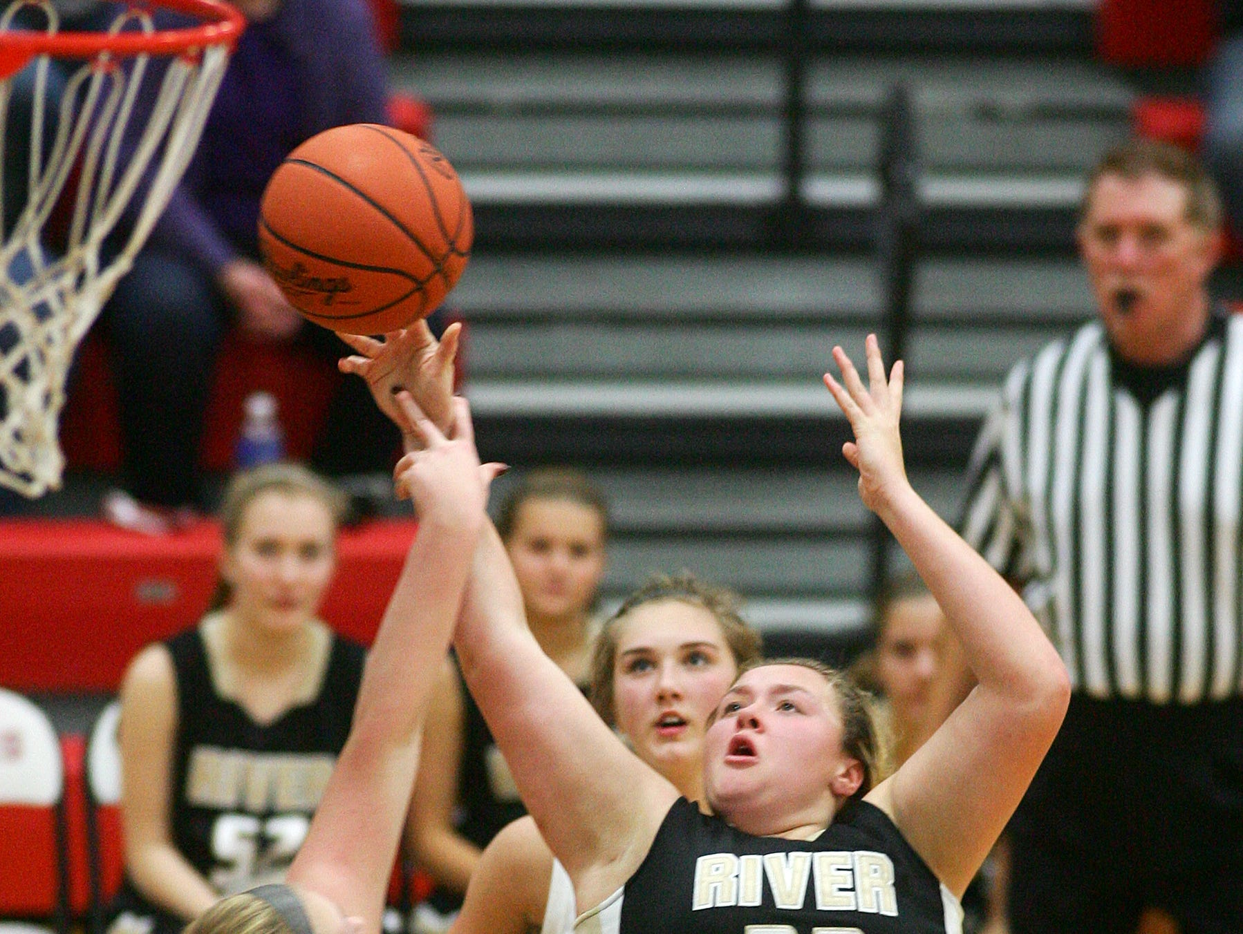 River View sophomore Mackenzie Huff eyes the basket Wednesday during the team's 41-28 victory over Coshocton.