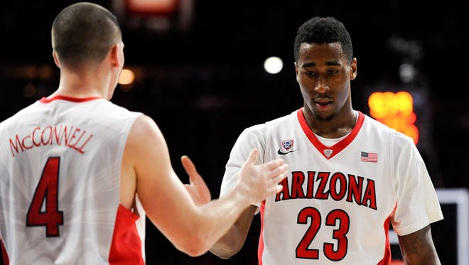 Arizona Wildcats forward Rondae Hollis-Jefferson (23) and guard T.J. McConnell (4) high five during the first half against the Colorado Buffaloes at McKale Center in Tucson on Jan. 15, 2015.