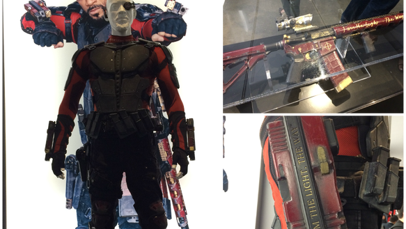 Deadshot's weapons-- and turtleneck-- have the same
