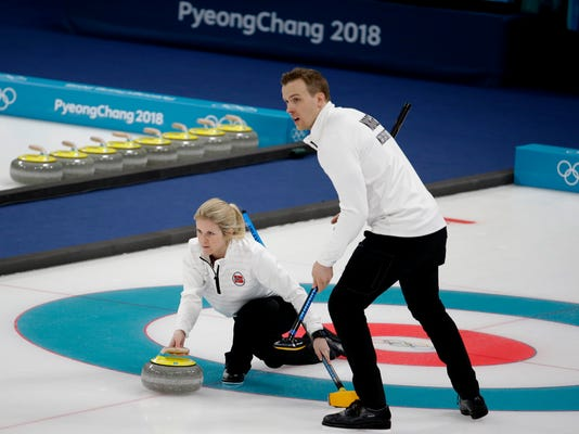 FILE - In this Feb. 13, 2018 file photo, Norway's Kristin Skaslien, left, throws the stone as teammate Magnus Nedregotten looks on during the mixed doubles bronze medal curling match against Russian athletes Anastasia Bryzgalova and Alexander Krushelnitsky at the 2018 Winter Olympics in Gangneung, South Korea. Nedregotten and his partner, who lost out on the Olympic bronze medal to Krushelnitsky,  charged with doping, said Tuesday, Feb. 20  he feels robbed of his moment of glory.  (AP Photo/Natacha Pisarenko, File)