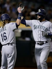 Outfielders Ben Gamel, left, and Mitch Haniger are