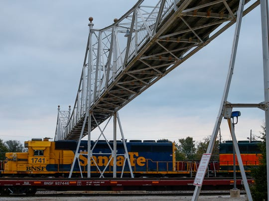 A train passes underneath the Jefferson Avenue Footbridge on Oct. 27. Springfield City Council is weighing several options for the 114-year-old Springfield landmark that closed in March following a safety evaluation.