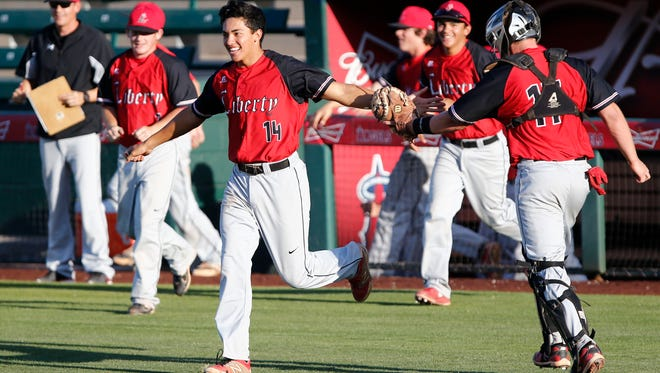 Peoria Liberty pitcher Nathan Pauga celebrates a victory over Phoenix Sandra Day O'Connor durng Division I double-elimination play.