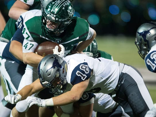 Greeneville's Ty Youngblood tries to gain yards against