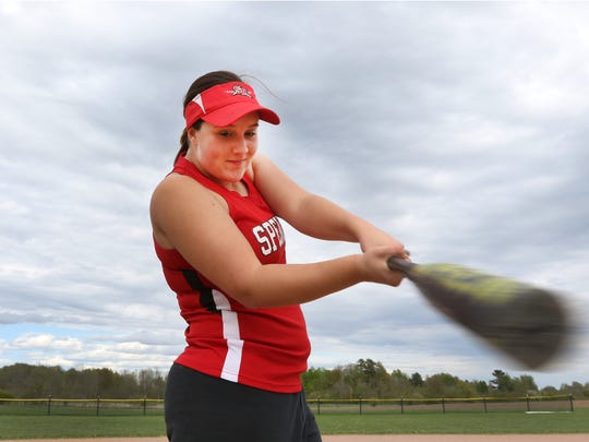 Spencer High School's Kallie Reckner swings the bat for a portrait at the high school May 16, 2016.