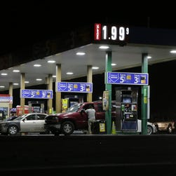 Motorists purchase gas at a station in Texas that dropped the unleaded fuel price to $1.99 per gallon on Aug. 26.