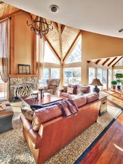 The living room now boasts a stone fireplace to help add a rustic touch.