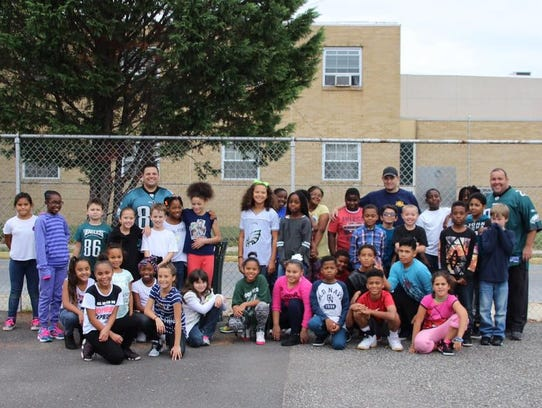 Students at R.D. Wood School welcome police visitors.