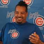 Manny Ramirez smiles during a news conference at Principal Park in Des Moines, Iowa Monday, June 30, 2014. Ramirez, a two-time champion with Boston and a two-time offender of Major League Baseball's rules against performance-enhancing drugs, joined the Triple-A Iowa Cubs as a player/coach after signing with Chicago in late May.