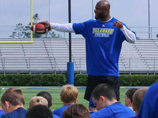 Former UD football player and current Carolina Panthers standout, Mike Adams, speaks during UD youth football camp Friday, June 26, 2015, at Delaware Stadium.