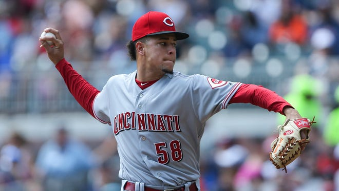 Cincinnati Reds starting pitcher Luis Castillo works in the first inning of the game against the Atlanta Braves on Sunday, Aug. 20, 2017, in Atlanta.