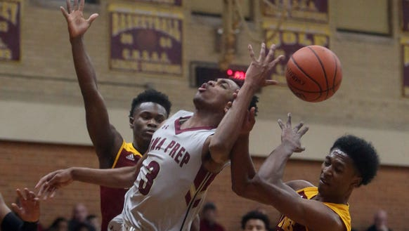 Bryce Willis of Iona Prep is fouled by Jontai Williams