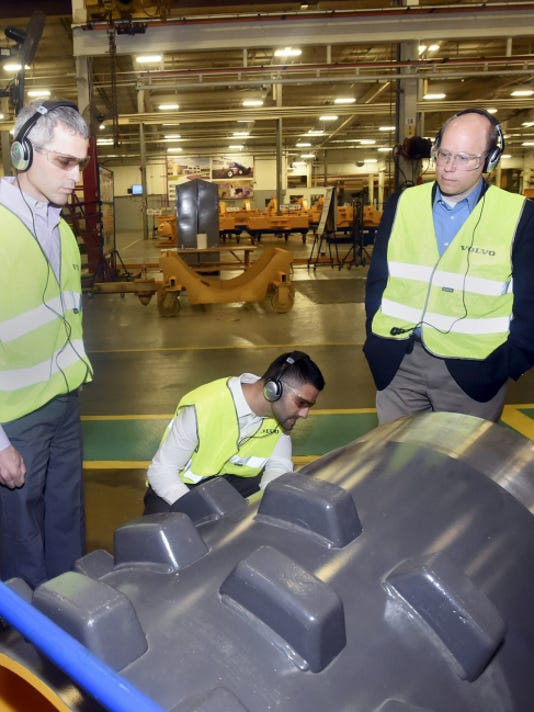 Members of the Pennsylvania house legislative manufacturing caucus including Rep. Rob Kauffman, Eli Evankovich, chairman of the manufacturing caucus, and Rep. Paul Schemel tour the Volvo construction equipment facility Thursday in Shippensburg.