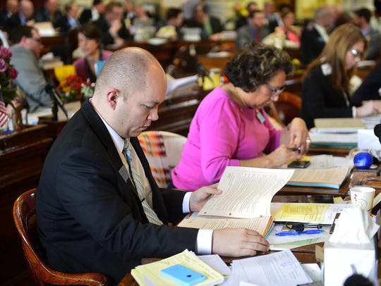 Rep. Casey Schreiner works during the 2015 session.