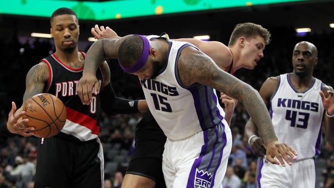 Dec 20, 2016; Sacramento, CA, USA;  Sacramento Kings forward DeMarcus Cousins (15) and Portland Trail Blazers forward Meyers Leonard (11) get tangled up during the third quarter at Golden 1 Center. The Kings defeated the Blazers 126-121.