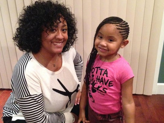 Doja Freeman during a recent trip to Los Angeles poses with Violet Nash at her home.