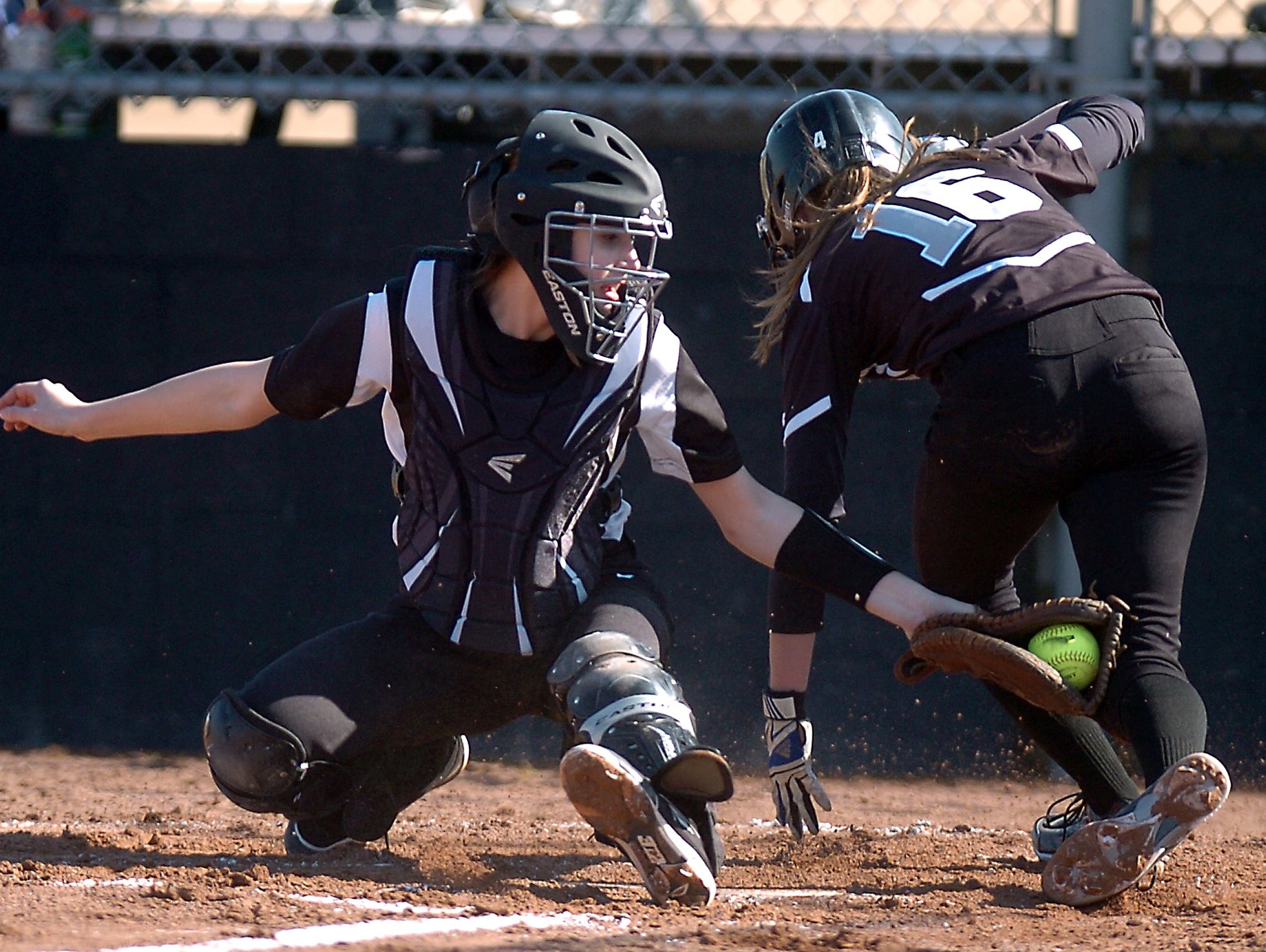East's Carly Petri reaches for a tag at the plate against Plymouth.