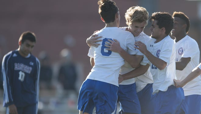 Washington Township players celebrate during a game last season. The defending Group 4 state champions still look like one of the best teams in South Jersey despite losing a lot to graduation.
