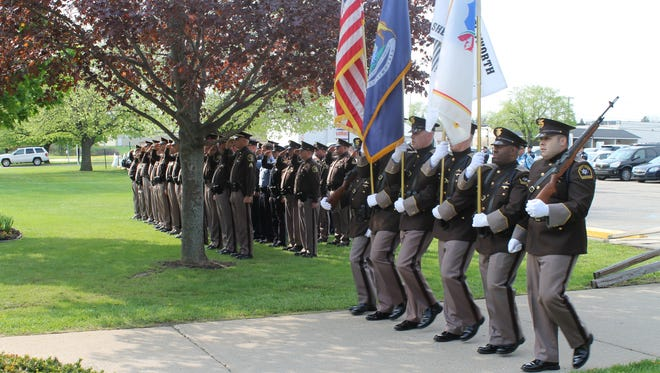 Michigan State Police Trooper Craig Scott was among 10 fallen Ingham County police officers who were honored during a ceremony in March 2015 in Mason. Shown is the Ingham County Sheriff's Office Honor Guard.
