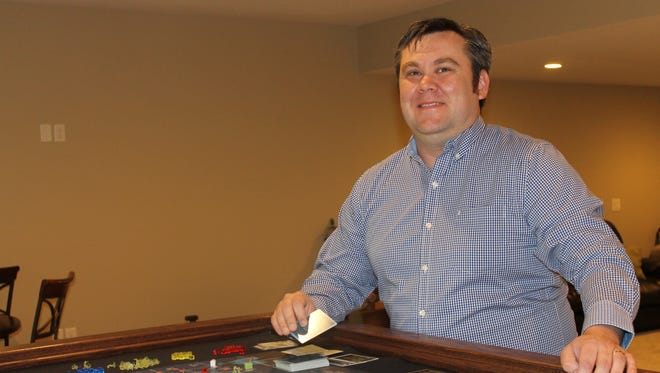 Travis Semmens, licensed independent social worker at Compass Clinical Associates in Urbandale, enjoys playing board games in his free time.