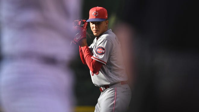 Jul 3, 2017; Denver, CO, USA; Cincinnati Reds starting pitcher Luis Castillo (58) prepares to deliver a pitch in the first inning against the Colorado Rockies at Coors Field. Mandatory Credit: Ron Chenoy-USA TODAY Sports