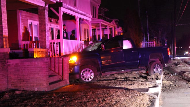 A pickup truck crashes into a power pole and then a house about 2 a.m. Monday in the 600 block of Jackson Street.