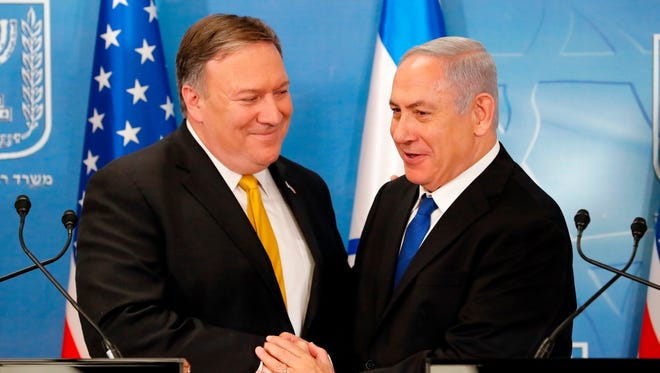 Secretary of State Mike Pompeo greets Israeli Prime Minister Benjamin Netanyahu ahead of a press conference at the Ministry of Defense in Tel Aviv April 29.