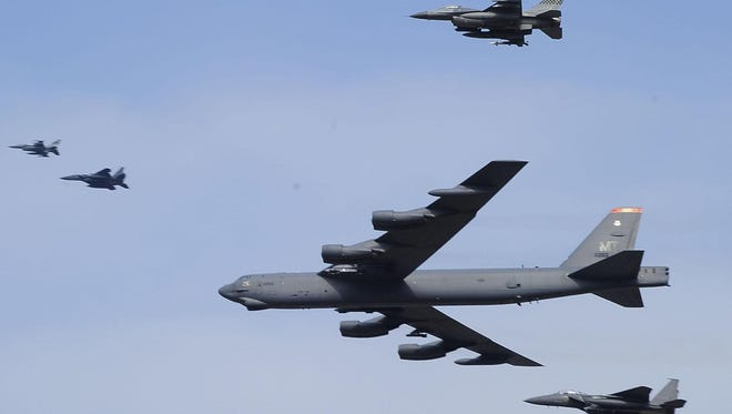 A U.S. Air Force B-52 bomber flies over Osan Air Base on Jan. 10 in Pyeongtaek, South Korea. The powerful bomber flew low over South Korea, a clear show of force from the United States as a Cold War-style standoff deepened between its ally Seoul and North Korea following Pyongyang's fourth nuclear test.