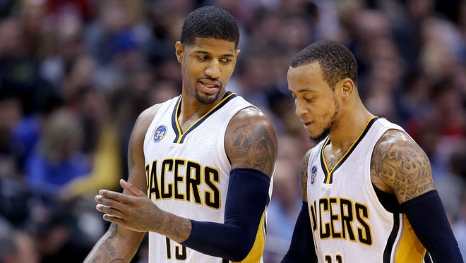 Indiana Pacers forward Paul George (13) talks with Monta Ellis (11) in the second half of their game Friday, Jan 15, 2016, evening at Bankers Life Fieldhouse. The Pacers lost to the Wizards 104-118.