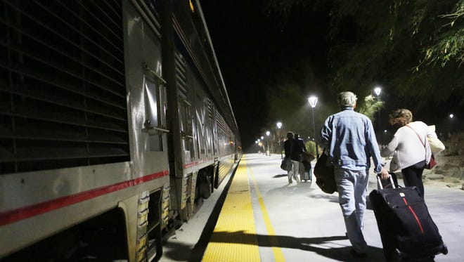 Passengers board the eastbound Amtrak Sunset Limited and Texas Eagle train at Palm Springs North Station on  June 4 in Palm Springs.