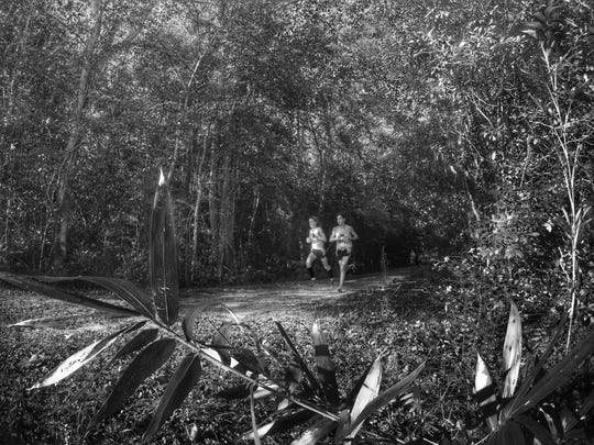 Maclay freshman Clay Milford and junior Jake Mazziotta exit the woods after 1.5 miles of Saturday's Aucilla Warrior Stampede.