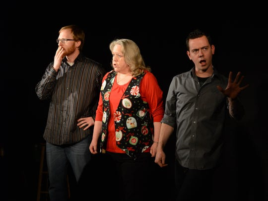 Dave Sundby (from left), Julie Harrison and Reverand Buerge perform improv at Capitol City Theater.