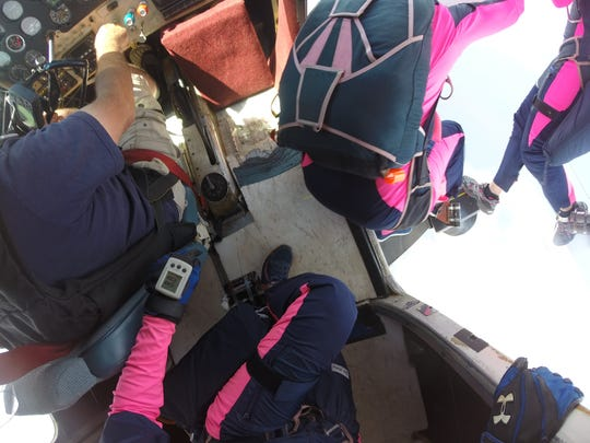 About 12,000 feet up, Amanda Scheffler is ready to